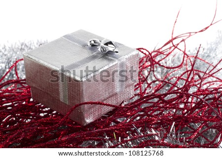 Beautiful gift box on red and silver