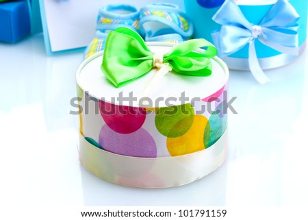 beautiful gifts and baby's bootees isolated on white