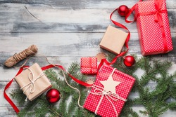 Beautiful gifts for Christmas with decor on wooden background