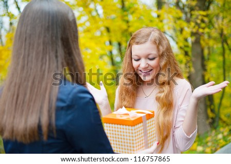 Beautiful girl accepting a gift on her birthday