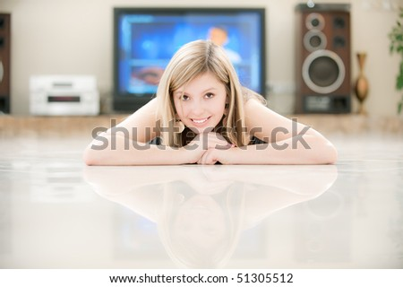 Beautiful girl against big TV