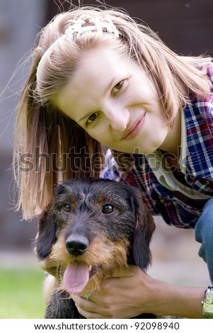 Beautiful girl and a hunting dog