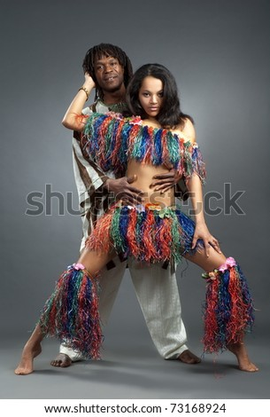 Beautiful girl and lad in african dance suit
