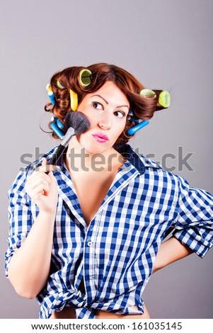 beautiful girl applying mascara