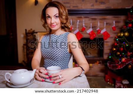 beautiful girl at the holiday table. Christmas holidays. Christmas decor. new year