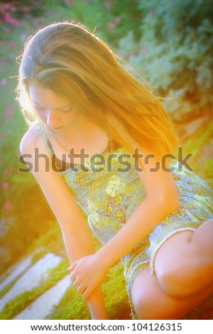 beautiful girl bathed in sunlit