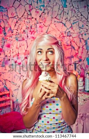 Beautiful girl bite cake - stock photo