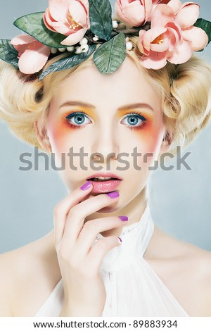 Beautiful girl blonde supermodel  in wreath of flowers closeup portrait. Series of photos