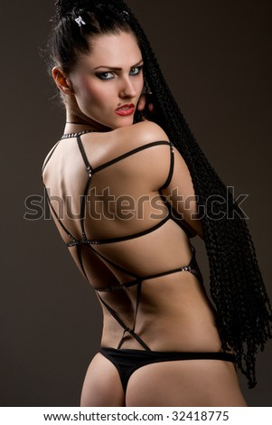 stock photo Beautiful girl body wearing fascinating black lingerie and