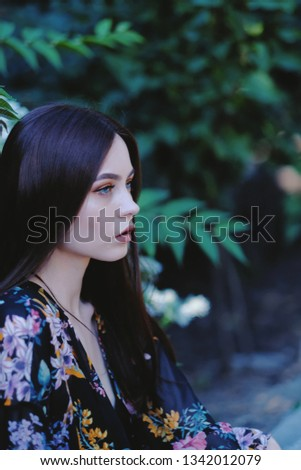 Beautiful girl. Bright flowers on the background. Fashion, style, beauty. Beauty template