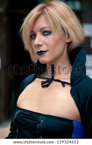 Beautiful girl close up portrait wearing a black medieval dress.