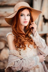Beautiful girl clothing style boho in autumn outdoor. Woman in hat