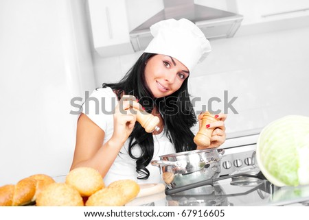 beautiful girl cooking in the kitchen at home and adding salt and pepper