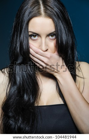 Beautiful girl covers her mouth with his hand
