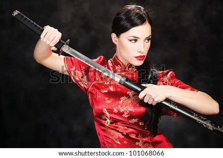 beautiful girl dressed in a kimono with katana in her hands
