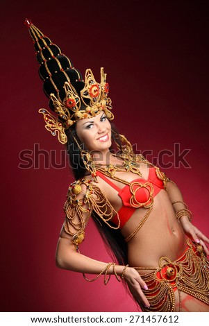beautiful girl dressed like a Thai dancer. dance moves. beautiful colorful costumes, vivid emotions