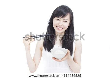 Beautiful girl eating rice with chop sticks, isolated on white background