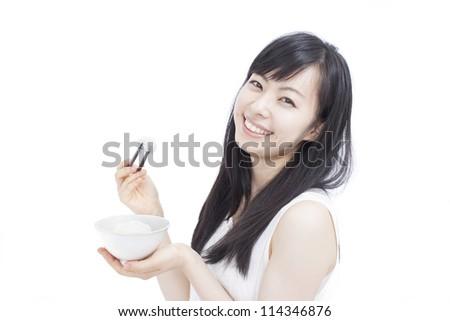 Beautiful girl eating rice with sticks, isolated on white background