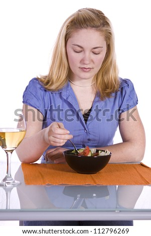 Beautiful Girl Eating Salad and Drinking Wine