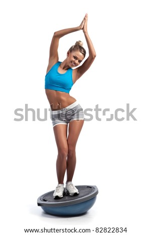 beautiful girl engaged in sports bosu - stock photo