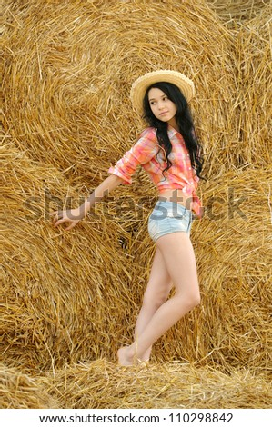 Beautiful girl enjoying the nature in the hay