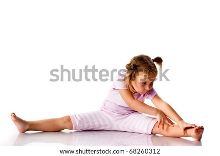 Beautiful girl exercising, stretching isolated on white