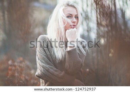 Beautiful girl freezing outdoor, autumn, cold, brown. blue