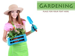 Beautiful girl gardener with flowers isolated on white