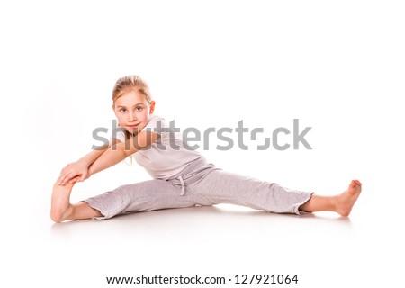 Beautiful girl gymnast  exercising, stretching isolated on white - stock photo