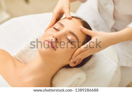 Photo of  Beautiful girl has a facial massage in a beauty clinic.