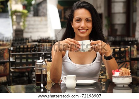 Beautiful girl having coffee at cafe