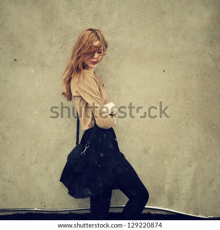 beautiful girl hipster against the wall