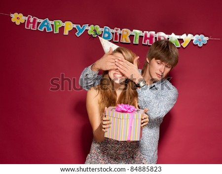 Beautiful girl hold gift with friend at birthday party