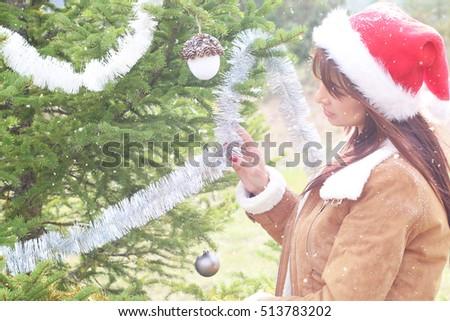 Beautiful girl holding a Christmas decoration