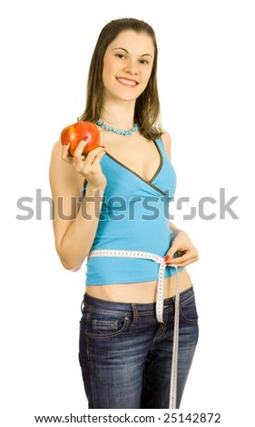 Beautiful girl holding an apple; isolated on white