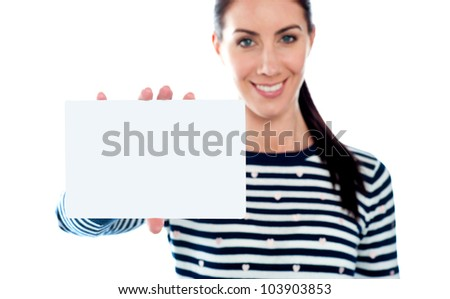 Beautiful girl holding blank card. Copy space. All on white background
