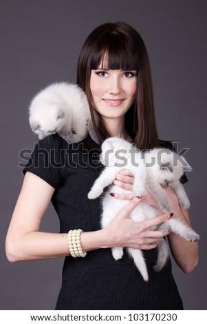 beautiful girl  holding little white kittens
