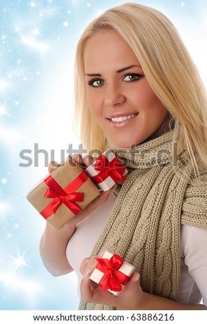 Beautiful girl holding the box present over snow background