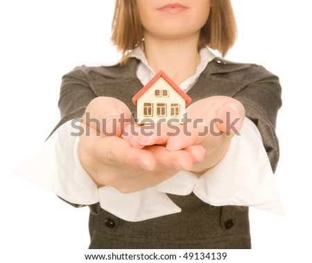 Beautiful girl holding toy house in her hand - stock photo