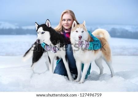 Beautiful girl hugging the dog. The girl with the siberian husky