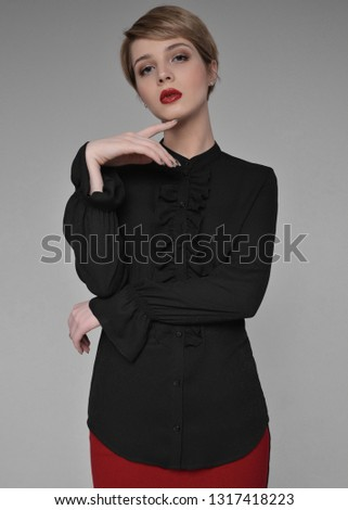 1b48c62ed0 beautiful girl in a black blouse and a red skirt. blonde with short hair on