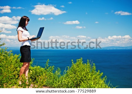 beautiful girl in a business suit with laptop