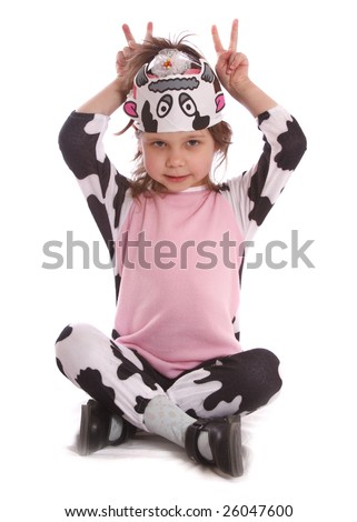 beautiful girl in a cow costume  isolated