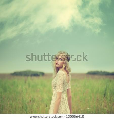 beautiful girl in a field in...