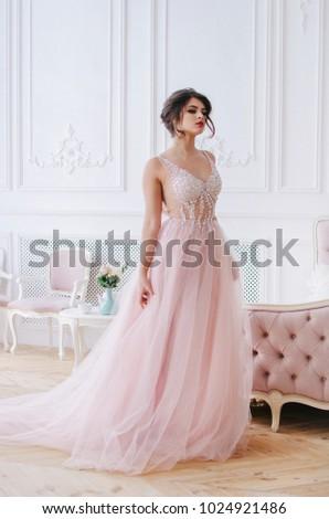 Beautiful girl in a luxurious long pink dress Foto stock ©