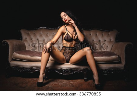 Beautiful girl in a sexy lingerie  on a sofa