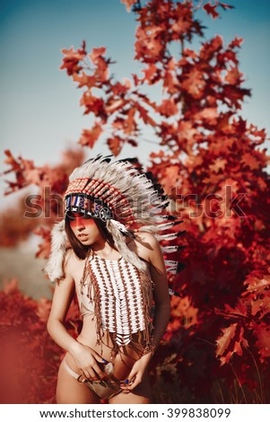 Beautiful girl in a suit of the American Indian #399838099