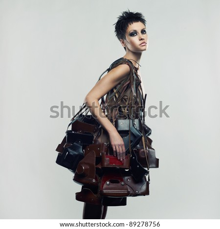 Beautiful girl in an unusual dress of the old photo cases