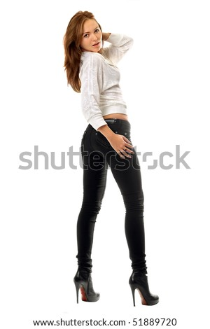 stock photo : Beautiful girl in black tight jeans. Isolated on white
