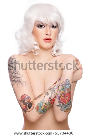 Beautiful girl in blond wig with stylish make-up and tattooed arms